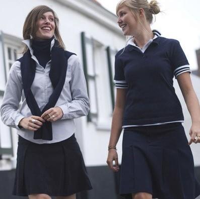 Vlaamse schoolmeisjes in uniform